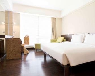 Novotel Manado Golf Resort & Convention Center - Manado - Schlafzimmer