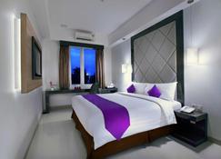Quest Hotel Balikpapan By Aston - Balikpapan - Bedroom