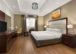 阿治曼華美達酒店和套房 - 阿治曼 - 阿吉曼 - 臥室