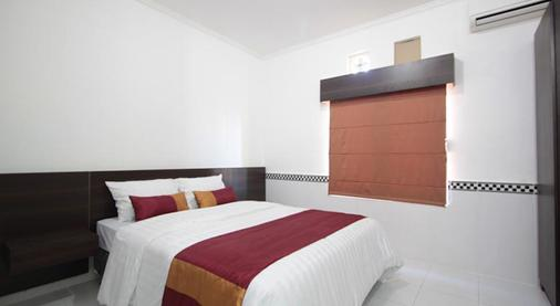 Bakung Sunset Hotel - Kuta - Bedroom