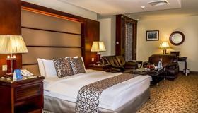 Days Inn by Wyndham Hotel Suites Amman - Amman - Bedroom