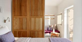 La Perla Villas And Suites - Oia - Habitación