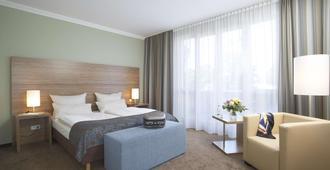 Hotel Central Regensburg - Regensburg - Makuuhuone