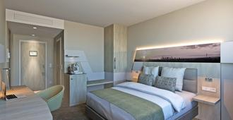 Holiday Inn Frankfurt Airport - Frankfurt - Yatak Odası