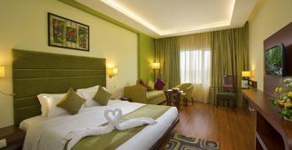 Hotel Atithi - פונדיצ'רי - חדר שינה