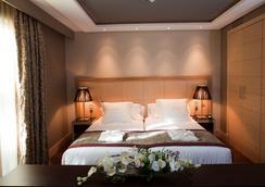 Nexus Valladolid Suites & Hotel - Valladolid - Schlafzimmer