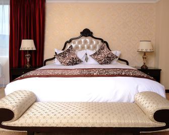 Alpha Hotel Mongolia - Ulaanbaatar - Schlafzimmer