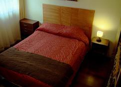 Nomades Apart Hotel - Castro - Sypialnia