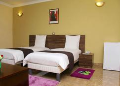 Melodie Hotel - Addis Ababa - Bedroom