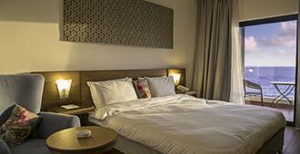 Sierra Palms Resort - Freetown - Schlafzimmer