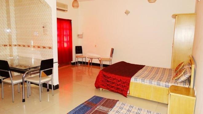 Prachi Holidays Home - Калангут - Спальня