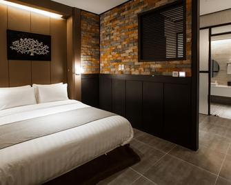 Cs Premier Hotel - Аньян - Спальня