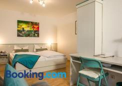 Hotel Amenity München - Munich - Bedroom