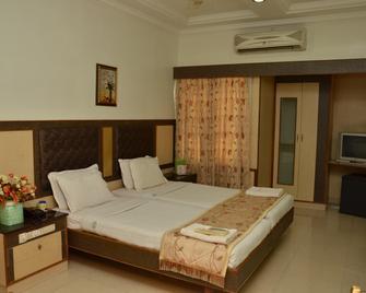 Hotel Aryaas - Tirunelveli - Bedroom