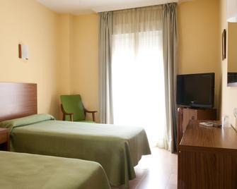 Hotel Hidalgo Quijada - Алькасар-де-Сан-Хуан - Спальня