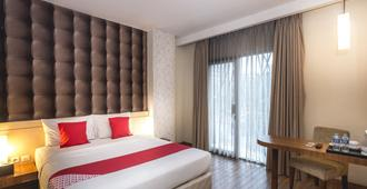 Hotel Feodora Grogol - ג'קרטה - חדר שינה