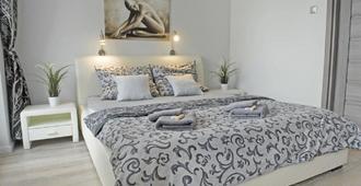 Apartamenty Nad Jeziorkiem - Warsaw - Phòng ngủ