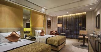 Wyndham Grand Plaza Royale Ningbo - נינגבו - חדר שינה