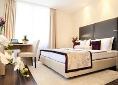 Hotel Merkur - Μπάντεν-Μπάντεν - Κρεβατοκάμαρα