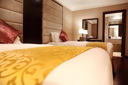 Holiday Jazan Hotel - Jazan - Schlafzimmer