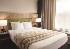 田納西州查塔努加 24 號州際公路西卡爾森鄉村旅館及套房酒店 - 恰塔努加 - 查塔努加 - 臥室