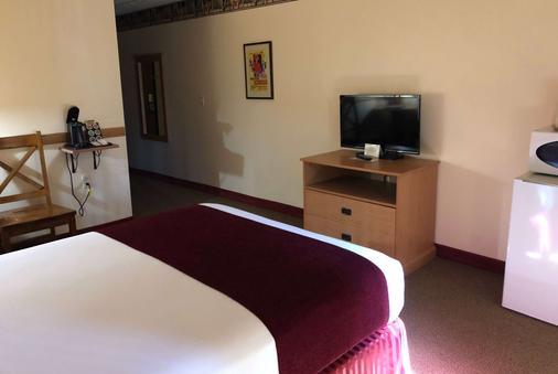 Travelodge Inn & Suites by Wyndham Deadwood - Deadwood - Bedroom