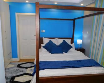 Livingspace Lodge - Лілонгве - Bedroom