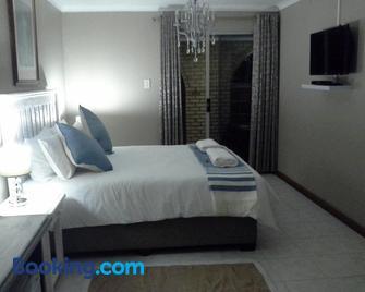 De Zevende Hemel Guesthouse - Secunda - Bedroom