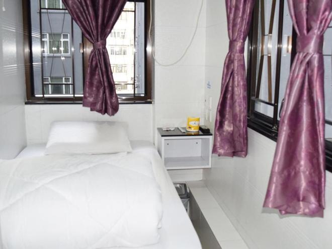 OM Guest House - Hongkong - Schlafzimmer
