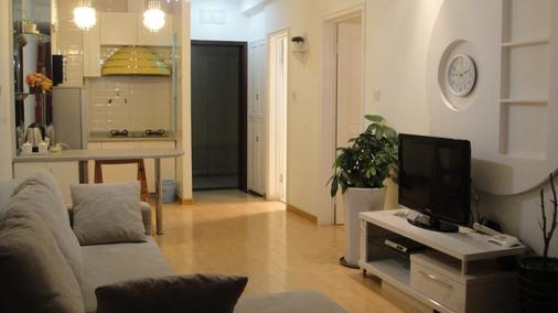 Kaifeng Apartment Hotel - Dalian - Living room