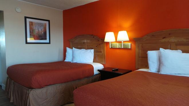 Executive Inn - Калхаун - Спальня