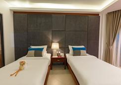 Baan Laimai Beach Resort & Spa - Patong - Schlafzimmer