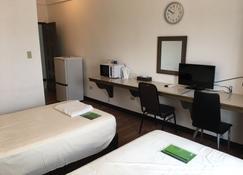 هيماواري هوتل - Garapan - غرفة نوم