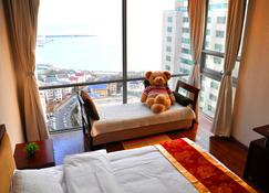 Qingdao Jinshan We Holiday Apt Olympic C - Qingdao - Habitación
