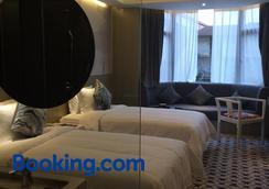 Paco Business Hotel Guangzhou Tianpingjia Metro Branch - Cantón - Habitación