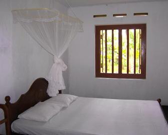 Mendis cottage - Велігама - Bedroom