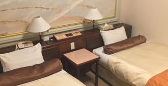 Hotel Sunny - טוקיו - חדר שינה