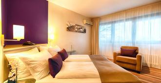 Leonardo Inn Hotel Hamburg Airport - Hamburg - Bedroom