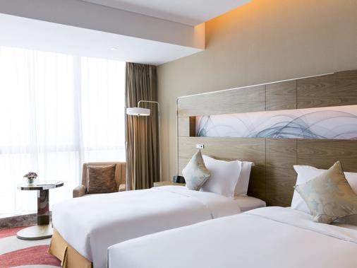Novotel Rizhao Suning - Rizhao - Schlafzimmer