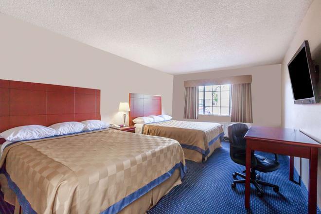 Days Inn by Wyndham Flagstaff I-40 - Flagstaff - Schlafzimmer