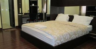 Allure Guest House - Bandung - Bedroom