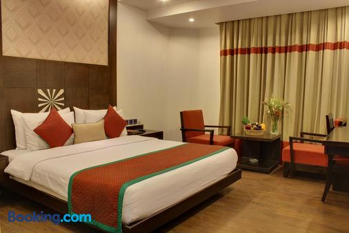 Hotel Godwin Deluxe - New Delhi - Phòng ngủ