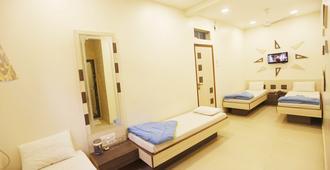Hotel Al Moazin - Mumbai - Schlafzimmer