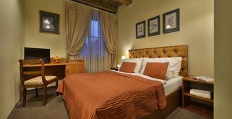 Hotel U Tri Pstrosu - פראג - חדר שינה
