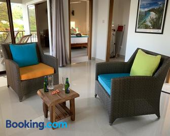 Whispering Palms Self Catering Apartment - Bel Ombre - Living room