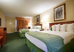 Best Western Orlando East Inn & Suites - Orlando - Bedroom