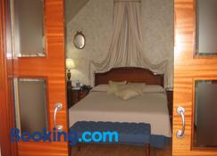 Hotel Santiago - Benavente - Schlafzimmer