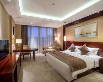 Changzhou Joyland Gloria Grand Hotels - Xueyan - Bedroom