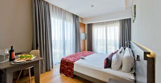 Ramada Resort by Wyndham Bodrum - Bodrum - Phòng ngủ