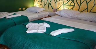 Blueroom & Hostal Omara - Trinidad - Bedroom